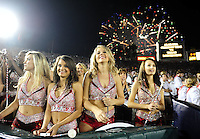 Jan 7, 2010; Pasadena, CA, USA; Alabama Crimson Tide dancers watch pregame warm-ups as fireworks explode over the Rose Bowl before the 2010 BCS national championship game between the Alabama Crimson Tide and the Texas Longhorns. Alabama won 37-21. Mandatory Credit: Mark J. Rebilas-.