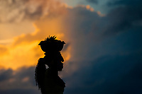 An Afro-Colombian girl, working as 'palenquera', carries a bowl full of fruits on her head during the sunset in Cartagena, Colombia, 12 December 2017. With the peace agreement, ending a 52-year civil conflict and promising political stability, together with rapid economic growth and unexploited tourism potential, Colombia has truly become a holiday destination. Cartagena, a UNESCO World Heritage site on the tropical Caribbean coast, plays the primary role in Colombia's tourism renaissance. The historic sites from the Spanish colonial times are being restored, private investments are visible throughout the city and an increased number of local people benefit from the boom of the travel related services.