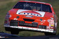 Michael Waltrip bounces off a curb during the 1996 NASCAR race at Sears Point Raceway near Sonoma, California.