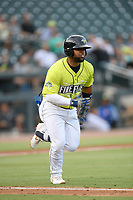 Second baseman Walter Rasquin (22) of the Columbia Fireflies runs toward first base in a game against the Augusta GreenJackets on Thursday, July 11, 2019 at Segra Park in Columbia, South Carolina. Columbia won, 5-2. (Tom Priddy/Four Seam Images)