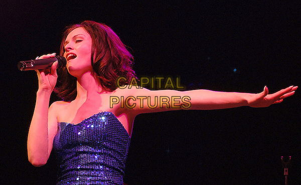 SOPHIE ELLIS BEXTOR.performing live at the 2007 V Festival, Hylands Park, Chelmsford, Essesx, England,.19th August 2007..half length live music on stage gig concert microphone blue sequined dress strapless hand arm.CAP/ BEL.©Tom Belcher/Capital Pictures.