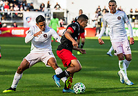 WASHINGTON, DC - MARCH 07: Victor Ulloa #13 of Inter Miami tackles Edison Flores #10 of DC United during a game between Inter Miami CF and D.C. United at Audi Field on March 07, 2020 in Washington, DC.
