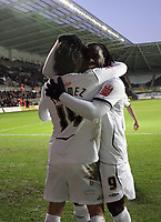 Pictured: (L-R) Jordi Gomez and Jason Scotland of Swansea City Celebrate <br />