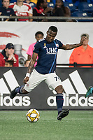 FOXBOROUGH, MA - SEPTEMBER 21: Cristian Penilla #70 of New England Revolution crosses the ball during a game between Real Salt Lake and New England Revolution at Gillette Stadium on September 21, 2019 in Foxborough, Massachusetts.