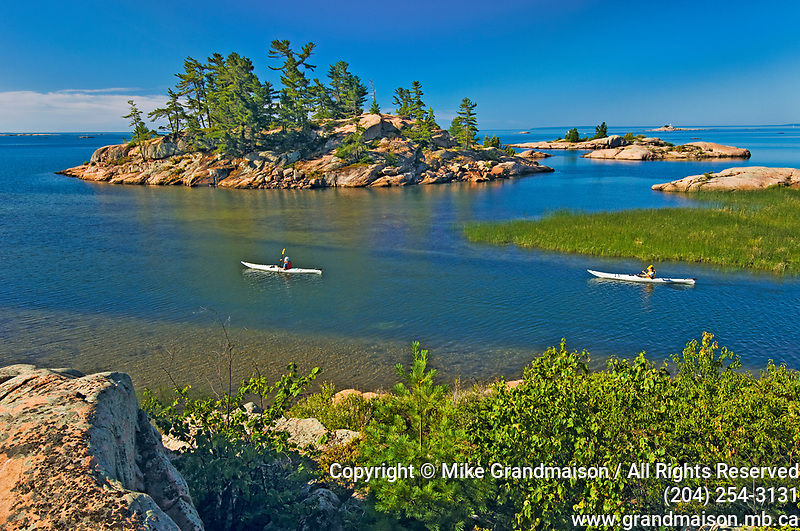 kayaking on Chikanishing River as it joins Collins Inlet at Georgian Bay<br />