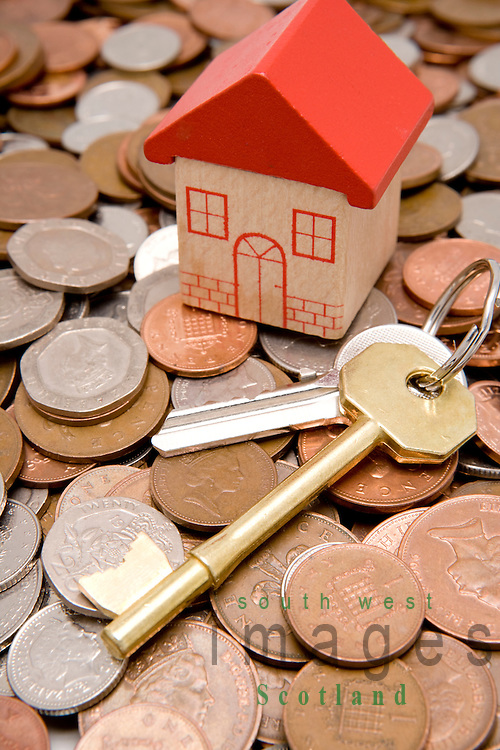 Financial investment in UK property market house keys and cash for investing in a new house or property