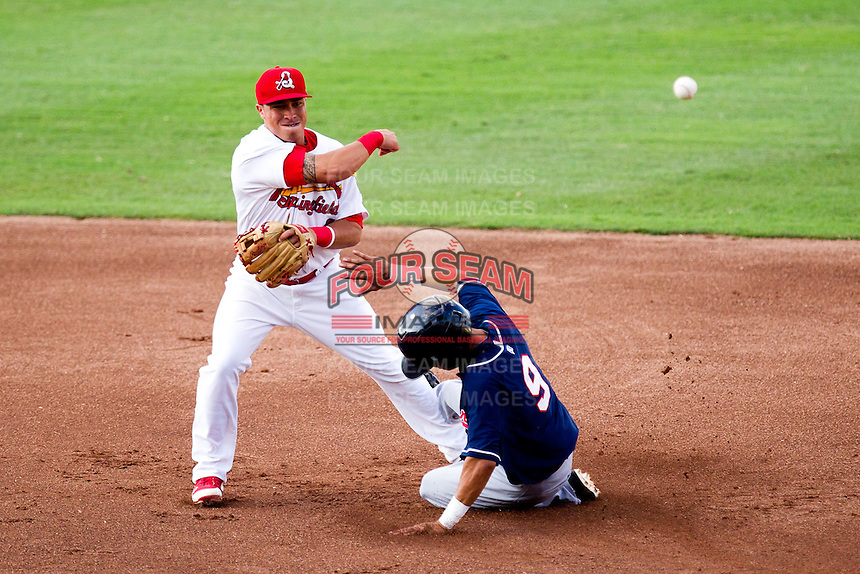 Kolten Wong (4) of the Springfield Cardinals turns a double play during a game against the Arkansas Travelers at Hammons Field on July 25, 2012 in Springfield, Missouri. (David Welker/Four Seam Images)