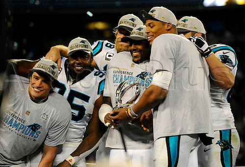 24.01.2016 . Charlotte, NC, USA.  Members of the Carolina Panthers including Luke Kuechly, Charles Johnson, Greg Olsen, Thomas Davis and Cam Newton hold up the George Halas Trophy after winning the NFC Championship over the Arizona Cardinals on Sunday, Jan. 24, 2016, at Bank of America Stadium in Charlotte, N.C