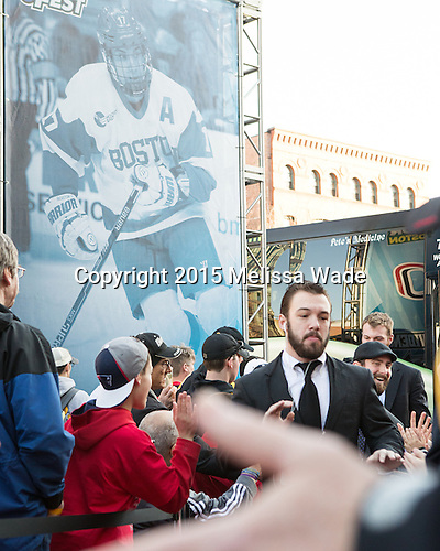 Cason Hohmann (BU - 7), Anthony Moccia (BU - 1) - The teams walked the red carpet through the Fan Fest outside TD Garden prior to the Frozen Four final on Saturday, April 11, 2015, in Boston, Massachusetts.