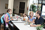 July 29, 2011. Cary, NC.. SAS employee John Pechachek, right, and his wife Michele, eat lunch with their children in one of the on campus cafeterias where an emphasis is put on healthy, affordable meals for employees.. Profile of SAS, a software company that has many amenities for its employees.
