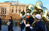 Members of Notre Dame's marching band the  walking to Yankee Stadium after pre game performance at the Macombs Park across from Yankee Stadium prior to Notre Dame vs. Army football game on Saturday, November 20, 2010. Photo by Errol Anderson.