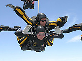 """Former United States President George H.W. Bush jumps with the United States Army Golden Knights Parachute Team at the Bush Presidential Library near Houston, Texas on June 13, 2004 to celebrate his his 80th birthday.  His jump was witnessed by 4,000 people including Actor and martial-arts expert Chuck Norris and Fox News Washington commentator Brit Hume.  Both also participated in celebrity tandem jumps as part of the event.  Bush made the jump harnessed to Staff Sergeant  Bryan Schell of the Golden Knights. Bush was reportedly contemplating a free-fall jump, but officials said the wind conditions and low cloud cover made it too risky.  Former Soviet President Mikhail Gorbachev was also on site. He was reportedly invited by Bush to join the jump, but said he had never parachuted and was too old to start. This was Bush's fifth jump. He also jumped with the Golden Knights on his 75th birthday. He said that he wanted to send a message to seniors that they """"still have a life.""""<br /> Credit: US Army via CNP"""