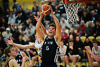 Callum McRae takes a rebound during the 2017 AA Boys' Secondary Schools Basketball Premiership National Championship match between Palmerston North Boys' High School and Cashmere High School at the B&M Centre in Palmerston North, New Zealand on Monday, 2 October 2017. Photo: Dave Lintott / lintottphoto.co.nz
