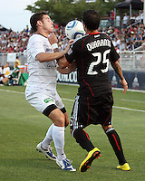 Santino Quaranta #25 of D.C. United clashes with Jason Hotchkin #11 of the Harrisburg City Islanders during a US Open Cup match at the Maryland Soccerplex on July 21 2010, in Boyds, Maryland. United won 2-0.