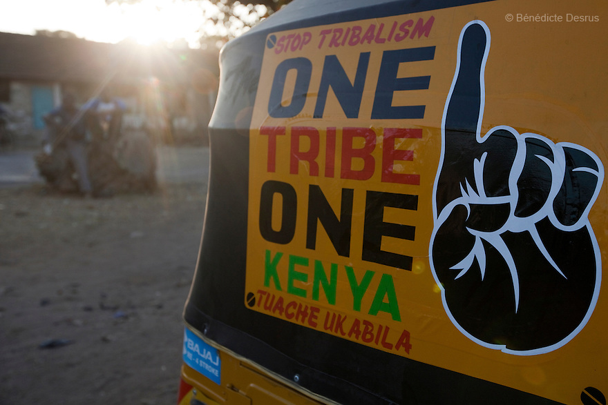"""28 february 2013 - Mombasa, Kenya - A Sticker with message:""""stop tribalism, One tribe One Kenya, Tuache Ukabila"""" on a matatu in Mombasa, Kenya. General elections will be held in Kenya on 4 March 2013. They will be the first elections held under Kenya's new constitution, promulgated in 2010. The last Kenya's elections left more than 1000 people dead and 650,000 displaced. Presidential candidate Uhuru Kenyatta is facing charges of crimes against humanity at the International Criminal Court (ICC) for his role in inciting the 2007-2008 post-election violence. Photo credit: Benedicte Desrus"""
