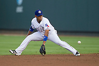 Round Rock Express second baseman Yangervis Solarte (26) fields a ground ball against the Iowa Cubs in the Pacific Coast League baseball game on July 21, 2013 at the Dell Diamond in Round Rock, Texas. Round Rock defeated Iowa 3-0. (Andrew Woolley/Four Seam Images)