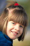 portrait of smiling young girl in park