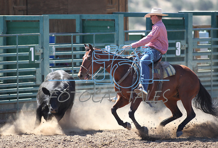 Phil MIller competes in the ranch horse class slack event at the Minden Ranch Rodeo on Saturday, July 23, 2011, in Gardnerville, Nev. .Photo by Cathleen Allison