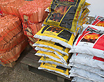 Bags of house coal and wood sticks for kindling
