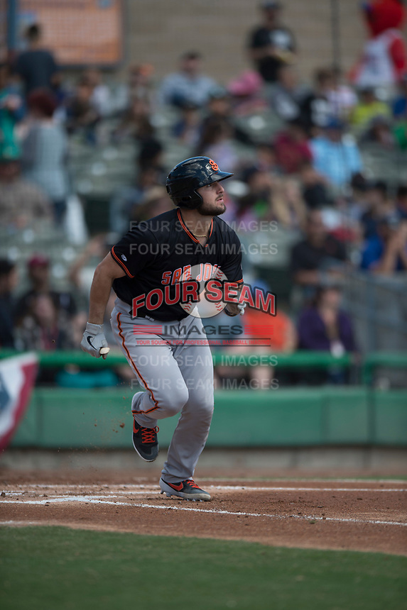 San Jose Giants catcher Joey Bart (9) hustles down the first base line after hitting a double during a California League game against the Stockton Ports on April 9, 2019 in Stockton, California. San Jose defeated Stockton 4-3. (Zachary Lucy/Four Seam Images)