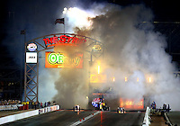 Oct 30, 2015; Las Vegas, NV, USA; NHRA jet cars race down track during qualifying for the Toyota Nationals at The Strip at Las Vegas Motor Speedway. Mandatory Credit: Mark J. Rebilas-USA TODAY Sports