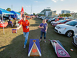 Clemson fans Jordan White, left, and Emily Tester play a game in the tailgating area before the 2017 College Football Playoff National Championship in Tampa, Florida on January 9, 2017.  Photo by Mark Wallheiser/UPI