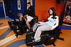 Boy and young woman using recumbent cycles at an inclusive fitness gym,