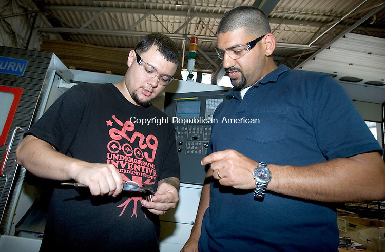NAUGATUCK CT. 16 July 2013-071613SV04-From left, Jose Mateo is trained by Diego Torrens, shop manager, at Concentric Tool &amp; Manufacturing Co. Inc. in Naugatuck Tuesday.<br /> Steven Valenti Republican-American