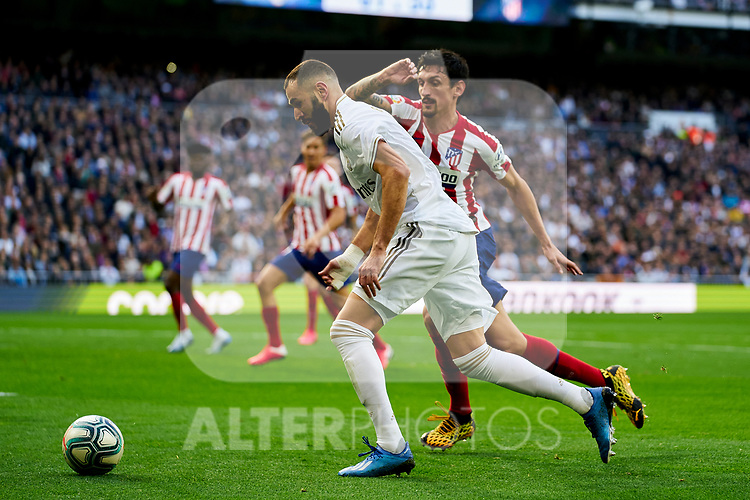 Karim Benzema of Real Madrid and Stefan Savic of Atletico de Madrid during La Liga match between Real Madrid and Atletico de Madrid at Santiago Bernabeu Stadium in Madrid, Spain. February 01, 2020. (ALTERPHOTOS/A. Perez Meca)