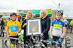 TV3's Sinead Kissane is presented with a picture of Ardfert Cathedral by Ardfert principal Betty Stack and students Kian O'Shea and Dillon O'Sullivan at the Ardfert Harvest Cycle on Saturday