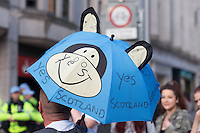 A protester holds up an umbrella in support of the Yes vote for the Scottish Independence Referendum during an anti-NATO demonstration in Cardiff, Wales, United Kingdom. On September 4, 2014.