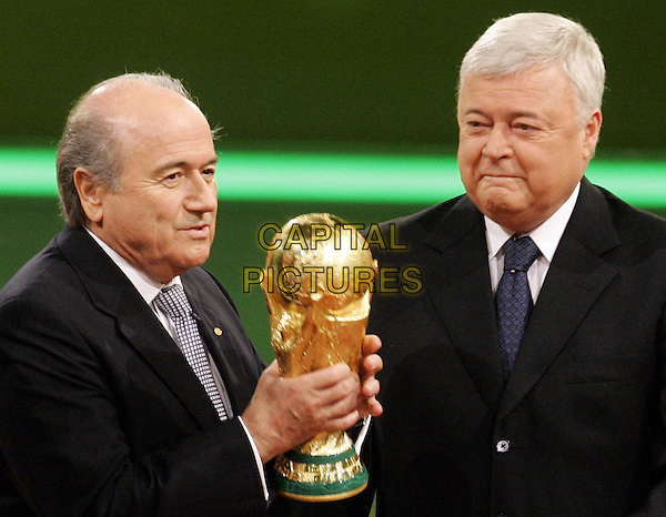 JOSEPH BLATTER & RICARDO TEIXEIRA.The Final Draw for the 2006 FIFA World Cup Germany in Leipzig. .December 9th, 2005.Photo: Brandt/ddp/Colourpress/Capital Pictures.Ref: Brandt/CPR.*UK Sales Only*.half length trophy award.www.capitalpictures.com.sales@capitalpictures.com.©Capital Pictures.
