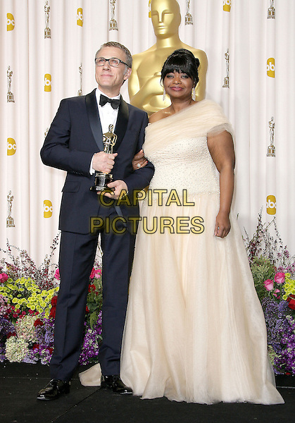 Christoph Waltz, Octavia Spencer.85th Annual Academy Awards held at the Dolby Theatre at Hollywood & Highland Center, Hollywood, California, USA..February 24th, 2013.pressroom oscars full length black tuxedo white off the shoulder dress glasses award trophy winner .CAP/ADM.©AdMedia/Capital Pictures.