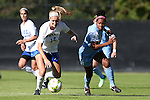 19 October 2014: Duke's Kara Wilson (15) and North Carolina's Amber Munerlyn (8). The Duke University Blue Devils hosted the University of North Carolina Tar Heels at Koskinen Stadium in Durham, North Carolina in a 2014 NCAA Division I Women's Soccer match. North Carolina won the game 3-0.