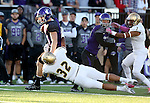 SIOUX FALLS, SD, OCTOBER 8:  Brady Rose #5 from the University of Sioux Falls is dragged down by Daniel Halverson #32 from Southwest Minnesota State University in the first half Saturday night at Bob Young Field. (Photo by Dave Eggen/Inertia)