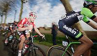 Tosh Van der Sande (BEL) grabbing a bidon in the feedzone<br /> <br /> Nokere Koerse 2014