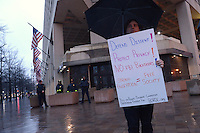 Washington, DC - February 23, 2016: A man holds a sign as protesters gather in front of the Federal Bureau of Investigation (FBI) headquarters in the District of Columbia, February 23, 2016, to stand against the FBI forcing Apple to break the iPhone encryption of one of the San Bernadino shooters. (Photo by Don Baxter/Media Images International)
