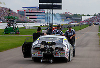 Aug 31, 2014; Clermont, IN, USA; NHRA pro stock driver Shane Tucker and crew being towed down the return road during qualifying for the US Nationals at Lucas Oil Raceway. Mandatory Credit: Mark J. Rebilas-USA TODAY Sports