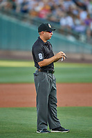 Umpire Jonathan Parra handles the calls on the bases during the game between the Salt Lake Bees and the El Paso Chihuahuas at Smith's Ballpark on August 17, 2019 in Salt Lake City, Utah. The Bees defeated the Chihuahuas 5-4. (Stephen Smith/Four Seam Images)