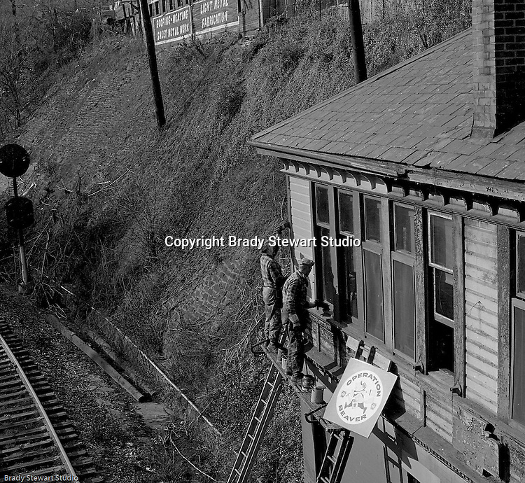 Corliss PA:  View of PA Railroad workers restoring a building as part of the company's Operation Beaver. &quot;Operation Beaver,&quot; was a paint-up, fix-up, and clean-up<br /> program of stations and cars intended to cosmetically cover deferred maintenances. Special posters and buttons were prepared as part of the campaign.<br /> These photos were used in a company newsletter to introduce the program company-wide.