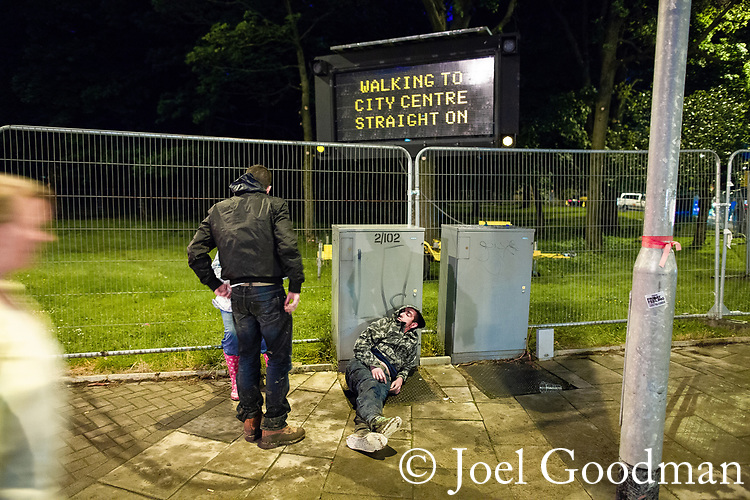 © Joel Goodman - 07973 332324 . 30/06/2012 . Manchester , UK . Crowds pour out of Heaton Park on to surrounding streets after the end of the Stone Roses Second Coming reunion gig . Photo credit : Joel Goodman