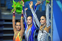 (L-R) Junior winners of team silver medal from Belarus are:  Ksenya Cheldishkina, Katia Galkina, Maria Kadobina at 2010 Pesaro World Cup on August 27, 2010 at Pesaro, Italy.  Photo by Tom Theobald.