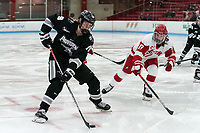 BOSTON, MA - JANUARY 11: Sara Hjalmarsson #19 of Providence College on the attack as Breanna Scarpaci #17 of Boston University defends during a game between Providence College and Boston University at Walter Brown Arena on January 11, 2020 in Boston, Massachusetts.