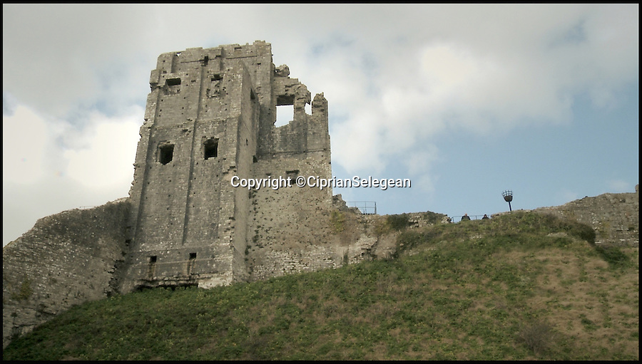 BNPS.co.uk (01202 558833)<br /> Pic: CiprianSelegean/BNPS<br /> <br /> The keep at Corfe Castle as it is today.<br /> <br /> A computer animation student is taking tourists back to medieval times with his painstaking transformation of the ruins of an ancient castle.<br /> <br /> Ciprian Selegean's footage is so realistic it looks like someone has filmed the towering stone fortress now, but he actually digitally reconstructed what Corfe Castle in Dorset looked like in its prime.<br /> <br /> The 22-year-old University of Portsmouth student spent several months researching the history of the important monument and then brought the castle to life using several software programmes to create a realistic, moving 3D representation.<br /> <br /> The clever historical reconstruction makes it look as if the impressive stronghold was never destroyed in 1646 and even has a guardsman standing watch at the castle gate. <br /> <br /> The digital image then falls away to reveal what people can actually see at the site today.