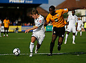 Charlie Henry of Newport is forced wide by Brian Saah of Cambridge United during the Blue Square Bet Premier match between Cambridge United and Newport County at the Abbey Stadium, Cambridge  on 25th September, 2010.© Kevin Coleman