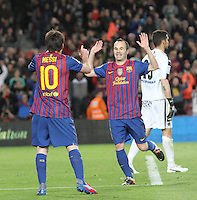 10.04.2012 Bacelona, Spain. La Liga. Picture show Leo Messi (L) and Andres Iniesta (R) after scoring during match between FC Barcelona against Getafe at Camp Nou