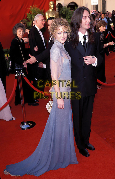 KATE HUDSON.Oscars 2001.Ref: 10754.Blue dress, small bag, full-length, hair up, unnamed male, see through dress, see thru.sales@capitalpictures.com.www.capitalpictures.com.©Capital Pictures