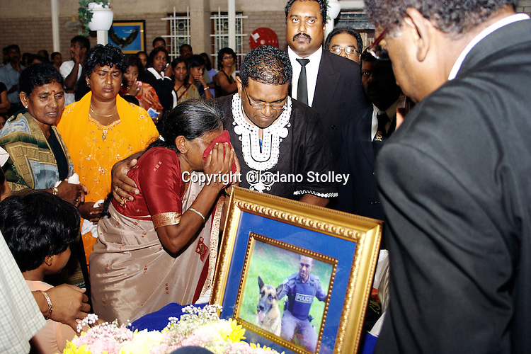 DURBAN - 25 February 2006 - African National Congress councillor Visvin Reddy comforts his mother at the funeral of his brother Sgt Selvan Reddy who was shot in what was believed to be a hit on the Durban City policeman..Picture: 36shots