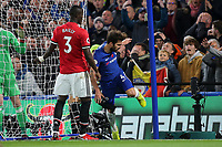 Cesc Fabregas of Chelsea trips over the camera at the side of the goal and moments later falls into the netting at the back of the goal during Chelsea vs Manchester United, Premier League Football at Stamford Bridge on 5th November 2017