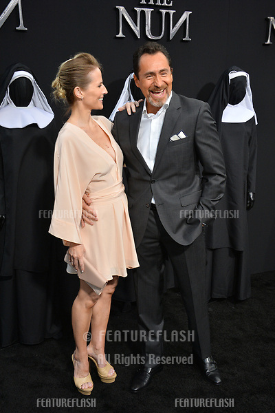 """LOS ANGELES, CA. September 04, 2018: Demian Bichir & Stefanie Sherk at the world premiere of """"The Nun"""" at the TCL Chinese Theatre, Hollywood."""